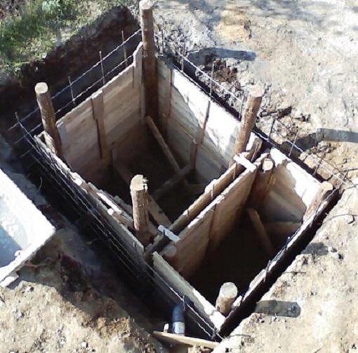 Пример двухкамерной сливной ямы